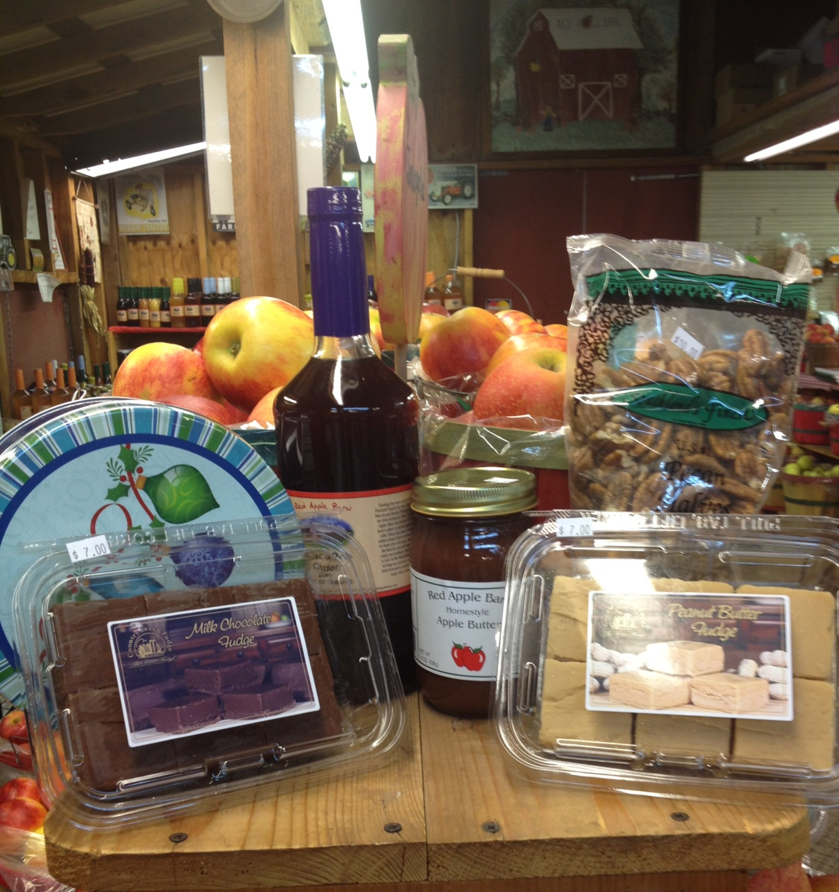 Farm store, apples and ciders, pies, caramel and candied apples, jams and jellies, bread, fritters, 		 cookbooks, candles