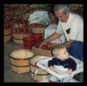 Marvin Pritchett boxing apples with grandson Zach at his side