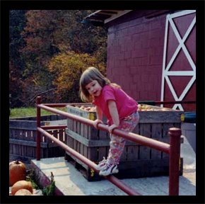 Breann Pritchett on the dock of the Red Apple Barn
