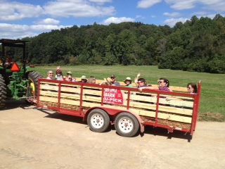 Apple pickers coming back from the orchard on the wagon ride
